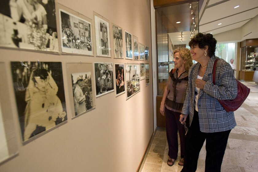 Judy Trussell (left) and Alicia Weinert viewed photos at the Coronado Public Library.