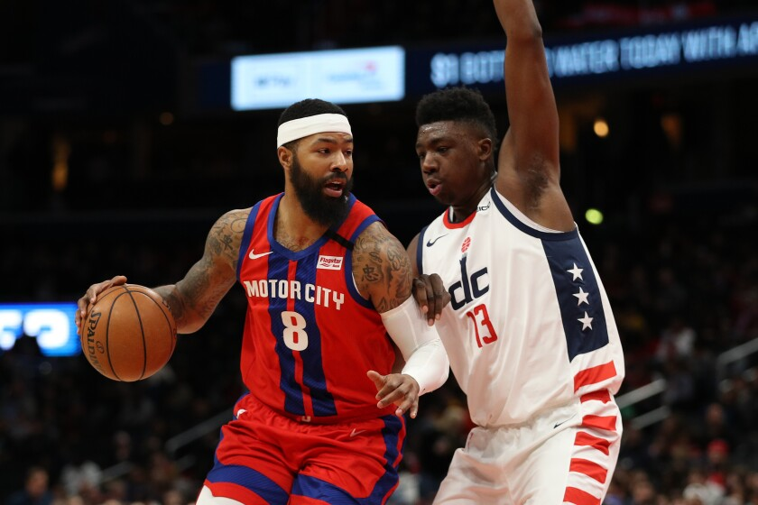 Markieff Morris drives against Wizards forward Thomas Bryant while playing for the Pistons on Jan. 20, 2020.
