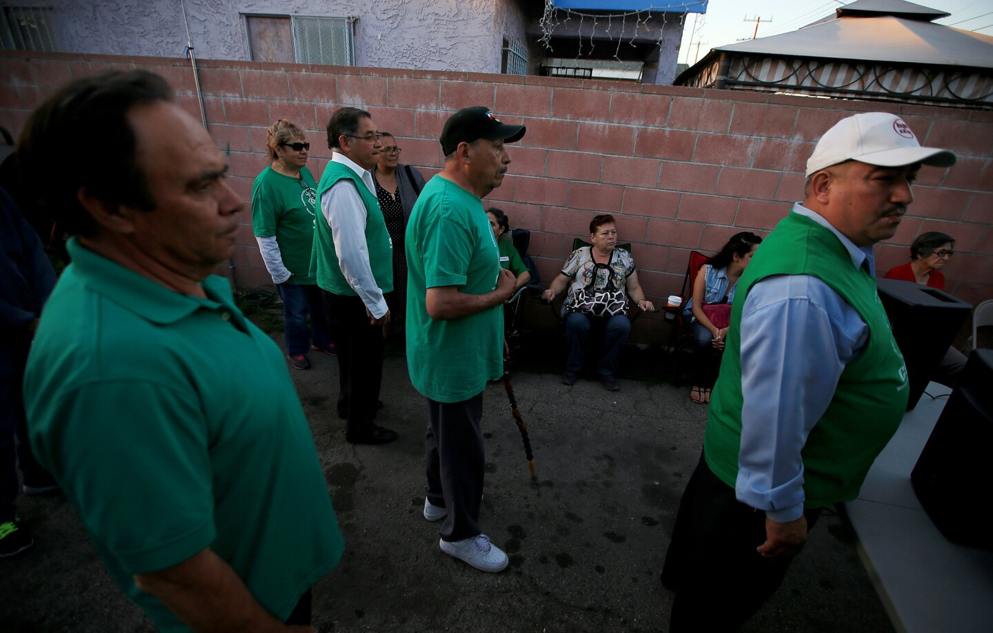 Community members and activists gather in a backyard of a home east of downtown Los Angeles to celebrate the closure of the Exide Tchnologies battery recycling plant.