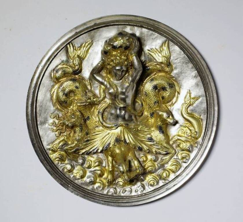 """A Sicilian medallion of silver and gold, made circa 300-212 BC, depicts Scylla of """"Odyssey"""" fame."""