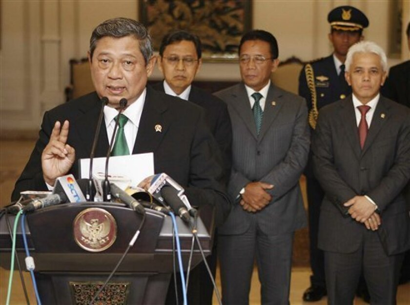 In this photo released by Indonesian Presidential office, Indonesian President Susilo Bambang Yudhoyono gestures as he speaks during a press conference announcing the cancellation of his trip to the Netherlands in Jakarta, Indonesia, Tuesday, Oct. 5, 2010. Yudhoyono abruptly canceled the state visit after overseas separatists demanded his arrest. (AP Photo/Presidential Office, Abror Rizki)