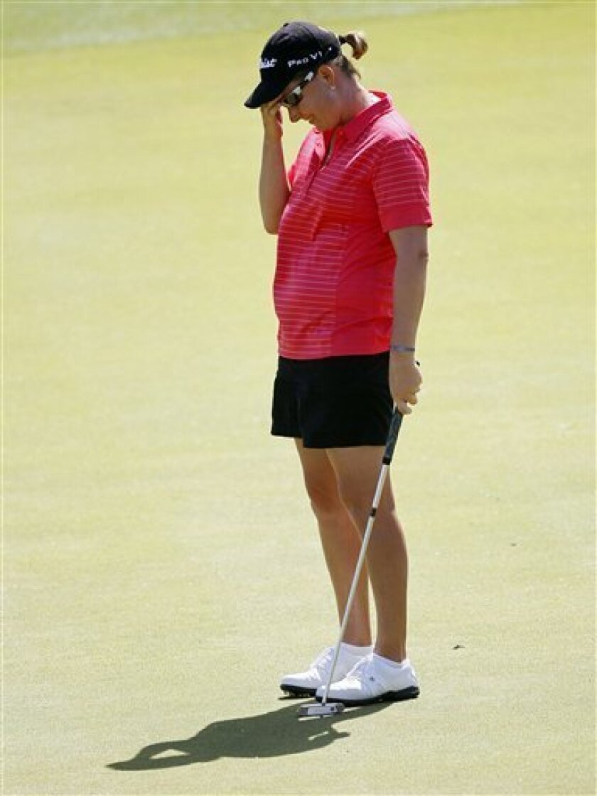 Lindsey Wright, of Australia, reacts to a missed birdie putt on the fifth green during the third round of the LPGA Kraft Nabisco Championship golf tournament, Saturday, March 31, 2012, in Rancho Mirage, Calif. (AP Photo/Matt York)