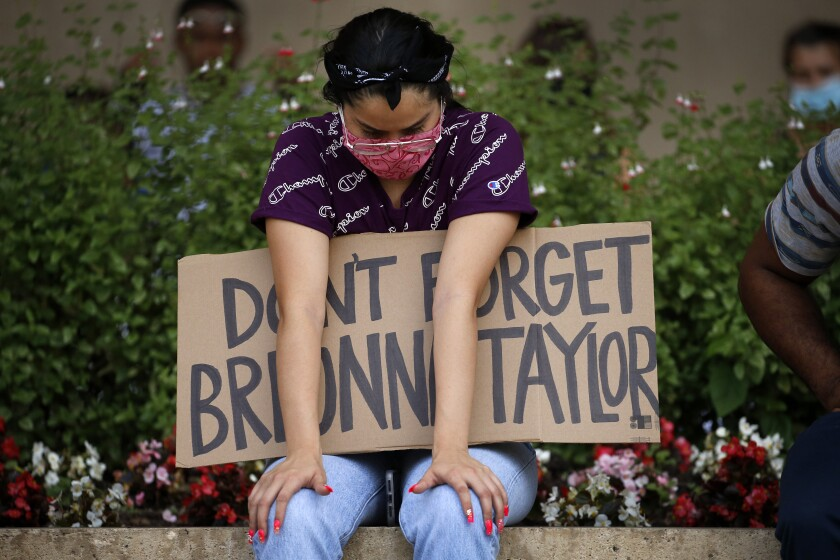 A protester honors Breonna Taylor at a Black Lives Matter rally June 3 in Dallas.