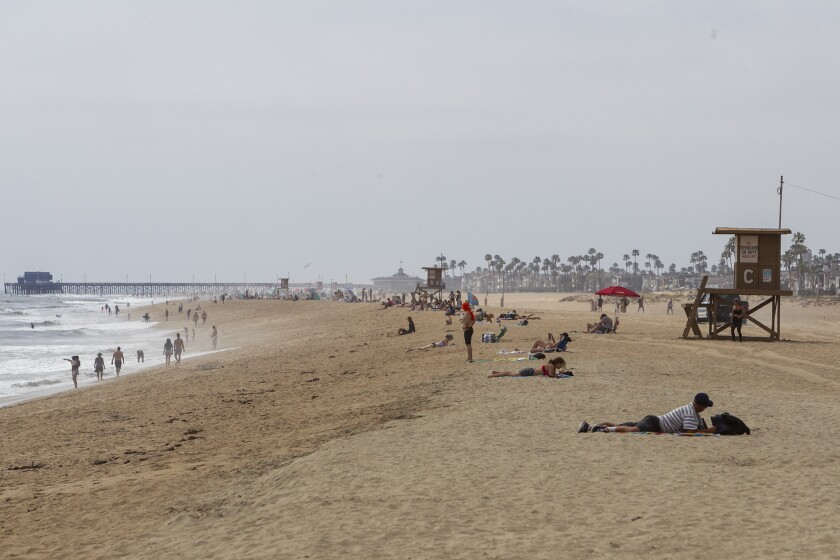 People were keeping their distance near the Balboa Pier in Newport Beach on Thursday.