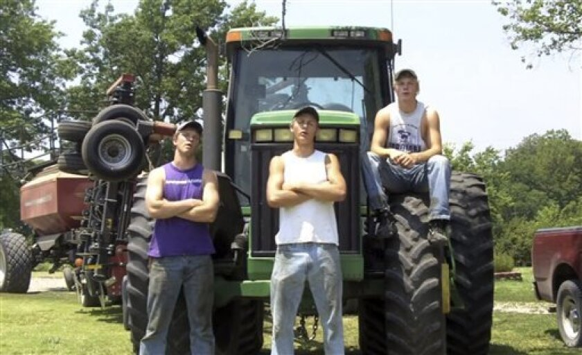 """This frame grab from video shows Assaria, Kan., brothers, from left: Nathan; Greg and Kendal Peterson in their video parody on LMAFO's """"Sexy and I Know It.""""  The parody, that has gone viral on YouTube and Facebook, shows the three brothers rapping their farming mission on the family's Saline County"""