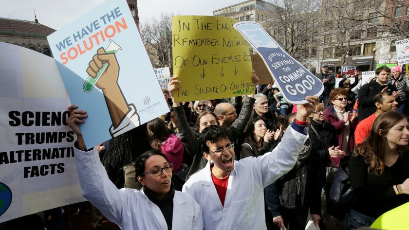 Members of the scientific community, environmental advocates, and supporters demonstrate against the Trump administration's stance on climate change on Feb. 19, in Boston.