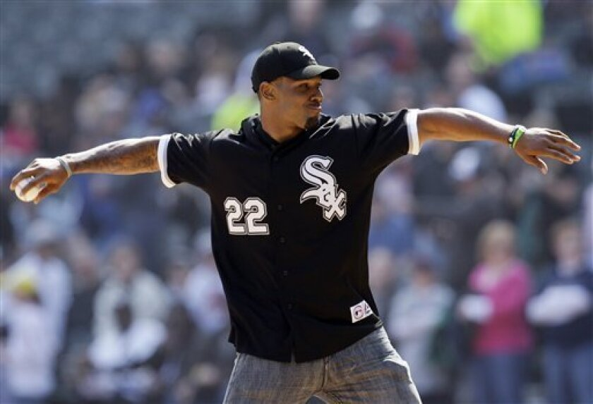 Chicago Bears running back Matt Forte throws out the first pitch before the Tampa Bay Rays-Chicago White Sox baseball game in Chicago, Saturday, April 9, 2011. (AP Photo/Nam Y. Huh)