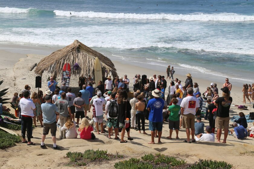 Memories of Dr. John Cherry were shared at a March 29 paddleout in his memory.