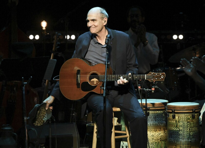 This Nov. 7, 2018 file photo shows James Taylor performing at JONI 75: A Birthday Celebration in Los Angeles. His 2020 joint concert tour with Jackson Browne was postponed on Friday because of the coronavirus pandemic.