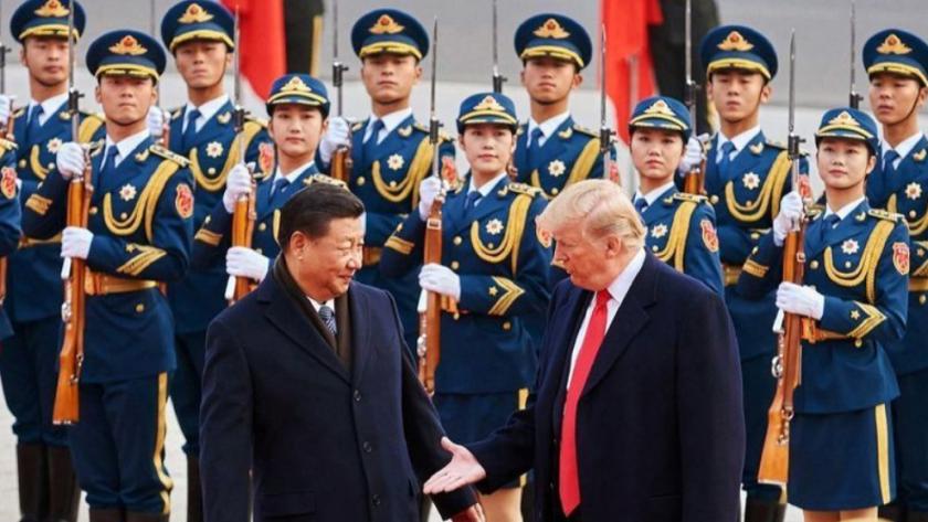 El presidente Trump, durante una visita de estado en noviembre de 2017, se reúne con el presidente chino, Xi Jinping, frente al Gran Palacio del Pueblo en Pekín. (Artyom Ivanov / Abaca Press)