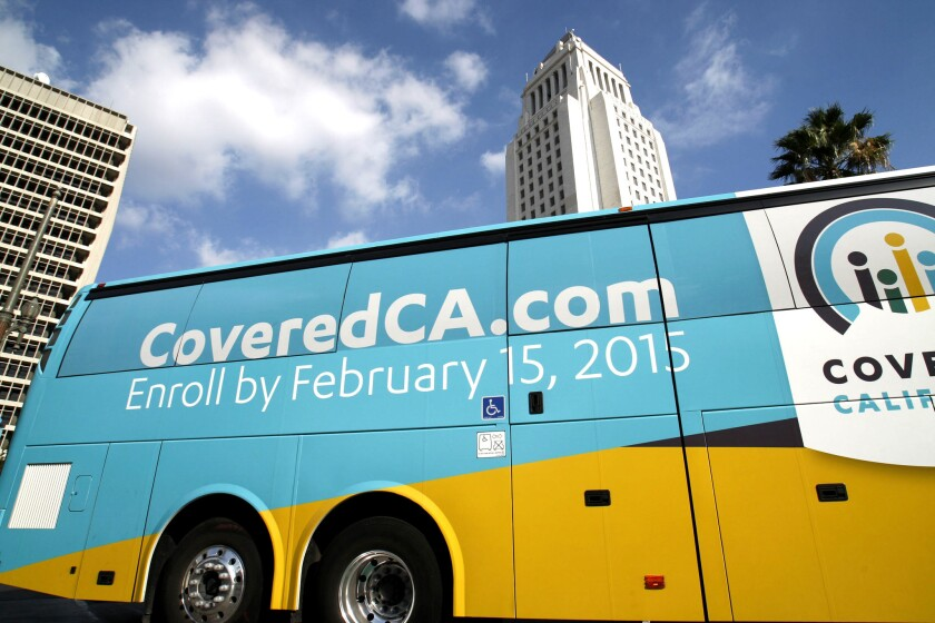 A Covered California bus departs Grand Park, in front of Los Angeles City Hall, last November. More than two-thirds of Californians uninsured before the Affordable Care Act now have coverage, a new report finds.