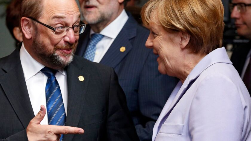 Then-European Parliament President Martin Schulz and German Chancellor Angela Merkel at European Union Council headquarters in Brussels in June 2015.