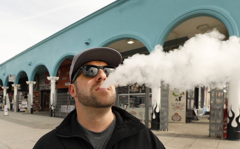 LOS ANGELES, CA - MARCH 26, 2019 Marc Bury, visiting from Germany vapes at the Venice Boardwalk in t