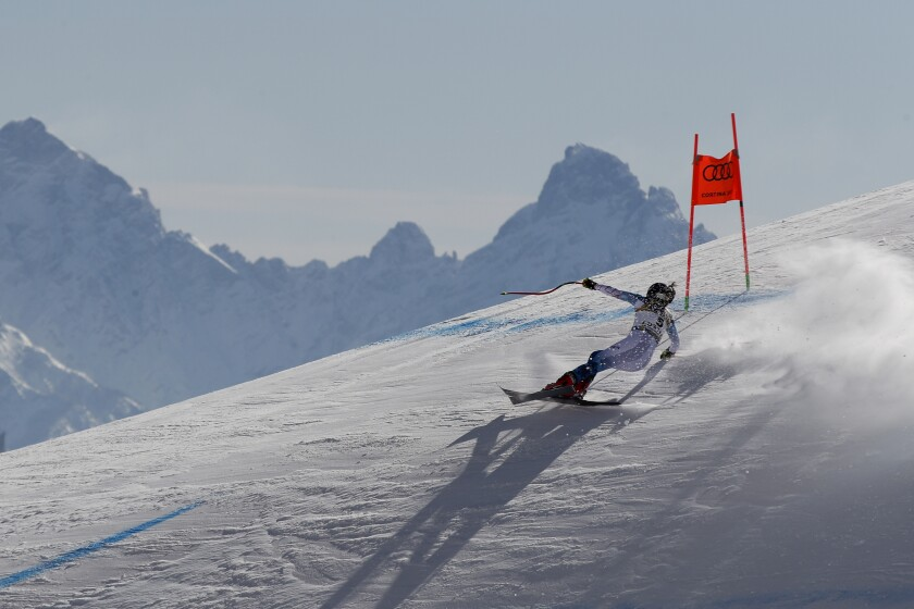 United States' Breezy Johnson speeds down the course during the women's downhill, at the alpine ski World Championships in Cortina d'Ampezzo, Italy, Saturday, Feb.13, 2021. (AP Photo/Gabriele Facciotti)
