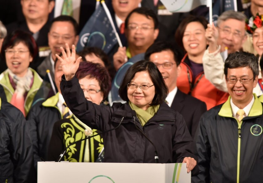 Democratic Progressive Party (DPP) presidential candidate Tsai Ing-wen (C) gestures as she celebrates alongside counterpart Chen Chien-jen (R) after winning the elections in Taipei.
