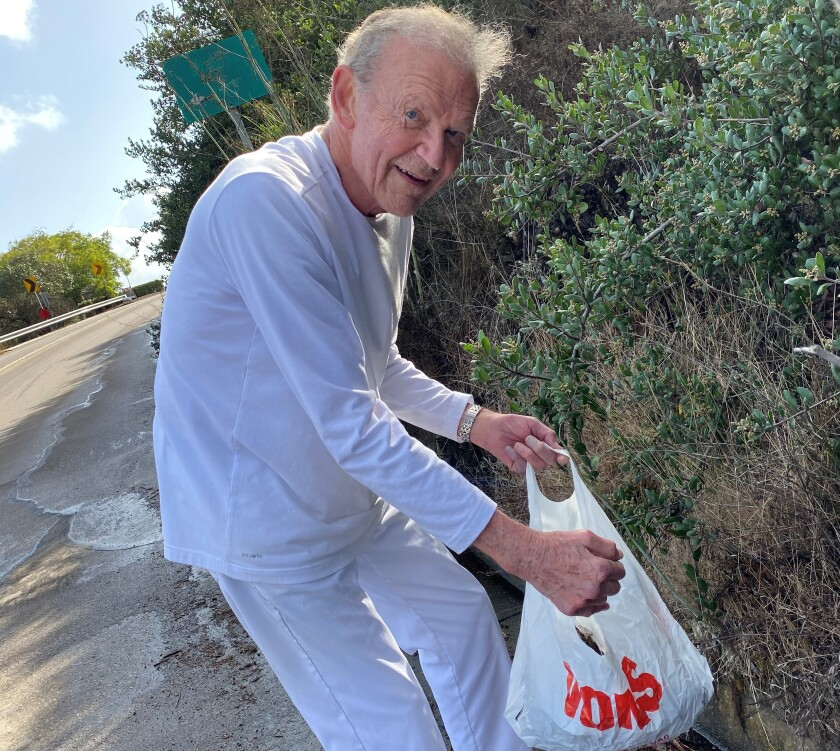 Former San Diego Superintendent Tom Goodman, 90, is neither too self-important nor too old to collect litter five mornings a week from Via Capri.