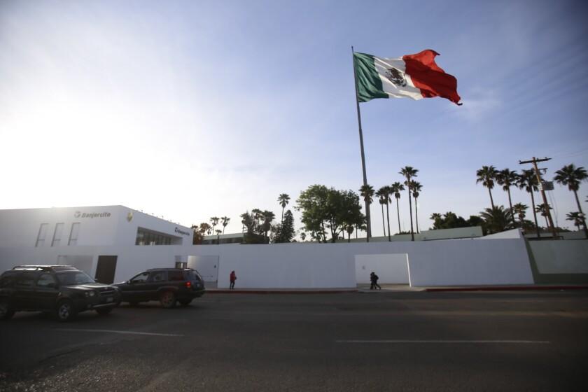 A giant Mexican flag flies on Thursday above Tijuana's Cuartel Morelos, a military base near downtown.