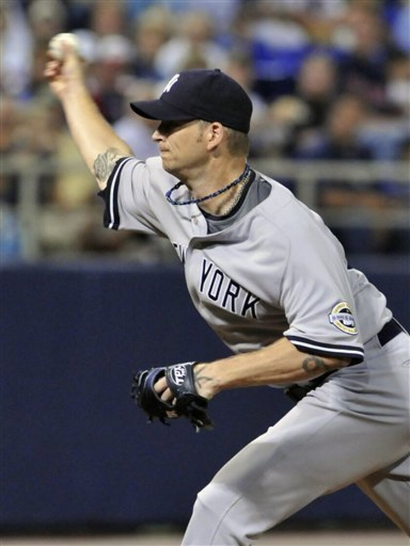 New York Yankees' A.J. Burnett pitches against the Minnesota Twins in the first inning of a baseball game Wednesday, July 8, 2009, in Minneapolis. (AP Photo/Jim Mone)