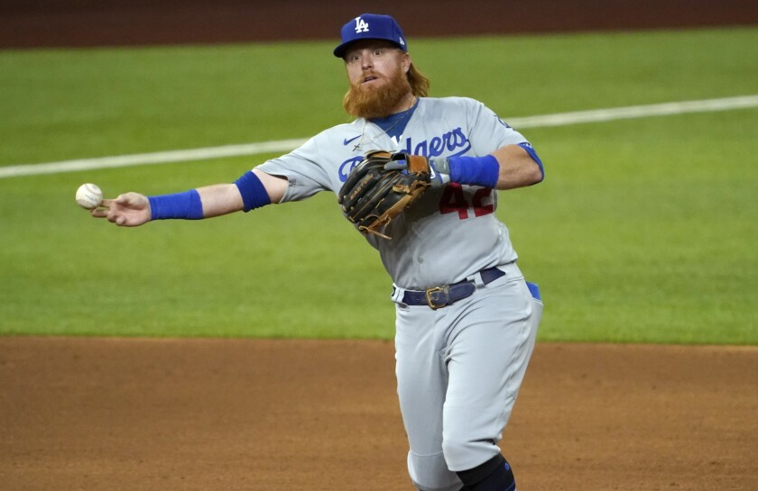 Los Angeles Dodgers third baseman Justin Turner throws to first for the out.