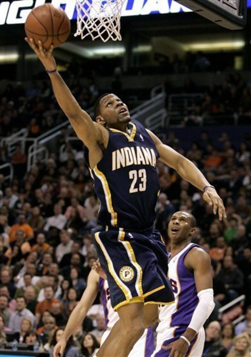 Indiana Pacers' Stephen Graham (23) scores past Phoenix Suns' Leandro Barbosa, of Brazil, during the second quarter of an NBA basketball game Wednesday, Jan. 7, 2009, in Phoenix. (AP Photo/Matt York)
