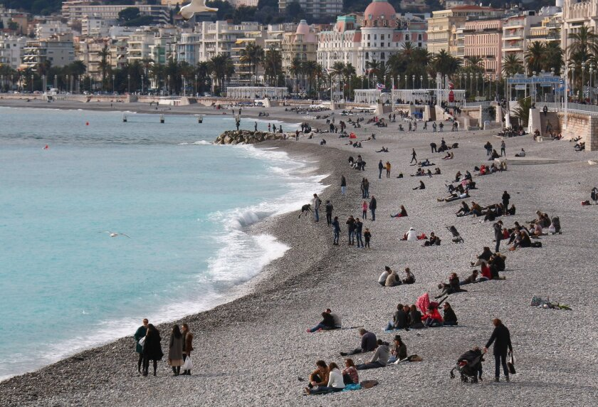 People sunbathe on the beach of Nice, southeastern France, on Jan. 24. A 16-year-old who flew alone to Turkey was from Nice.
