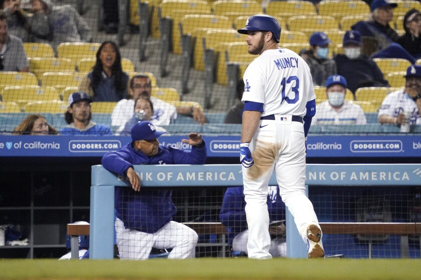 The Dodgers' Max Muncy looks toward home plate as he walks off the field after popping out.
