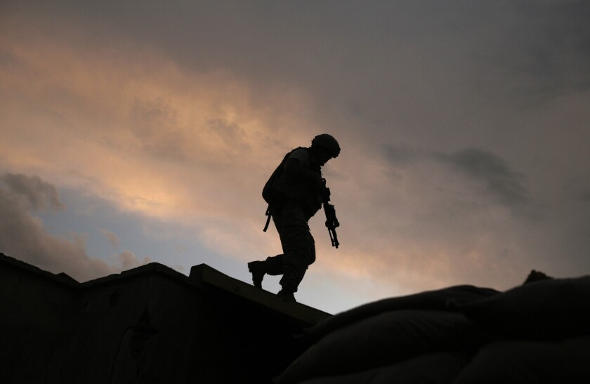 A U.S. soldier responds to shots fired at a combat outpost in Afghanistan's Wardak province.