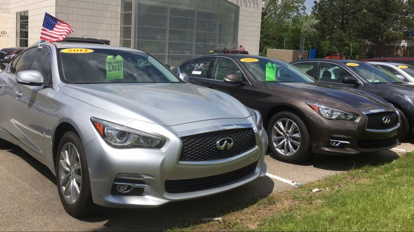 Used Infiniti Q50 luxury sedans await buyers at a dealership in the Detroit suburb of Novi, Mich.