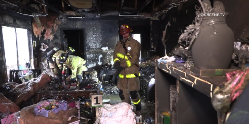 Firefighters put out a house fire that gutted a living room in Otay Mesa West on Tuesday.