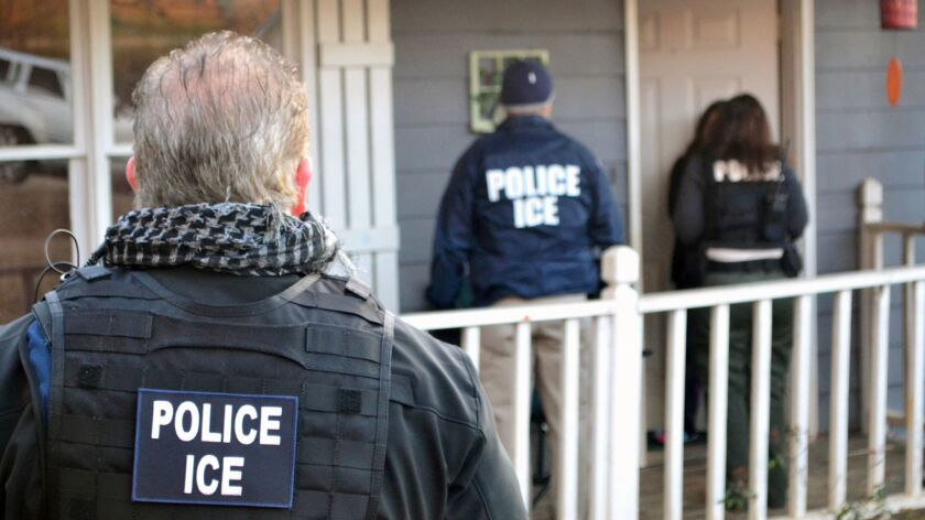 Immigration and Customs Enforcement agents at a home in Atlanta in February.