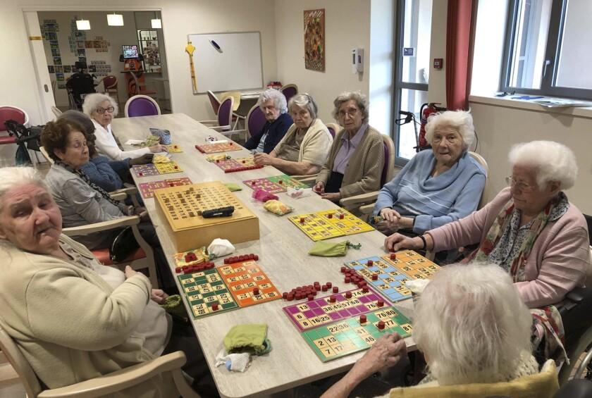 Virus Outbreak France Nursing Home Heroes