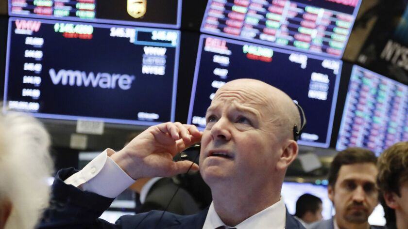 Trader Patrick Casey works on the floor of the New York Stock Exchange on Monday.