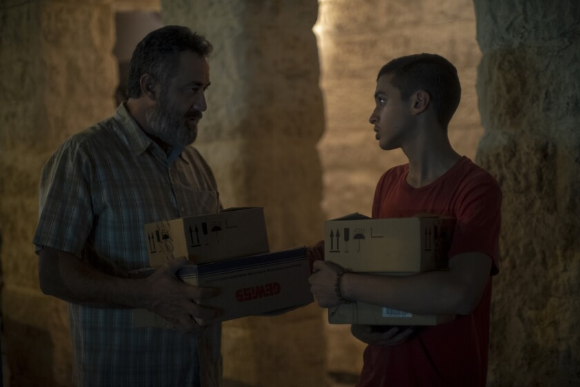 """Jony Arbid, left, and Ram Masarweh in HBO's """"Our Boys."""""""