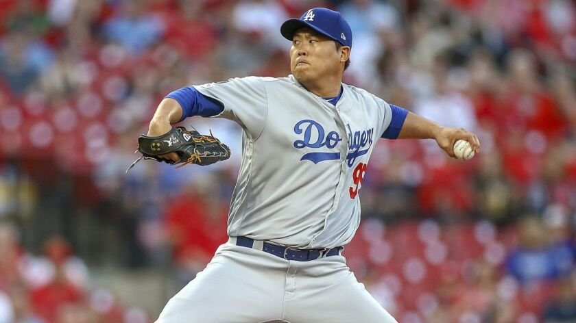 Los Angeles Dodgers starting pitcher Hyun-Jin Ryu throws during the first inning of a baseball game