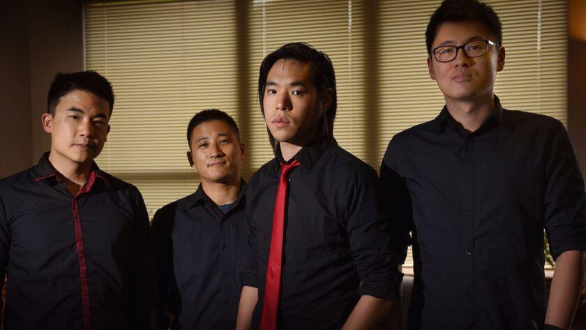 The Asian-American band The Slants, from left, Simon Young, (also known as Simon Tam), Yuya Matsuda, Ken Shima and Joe X. Jiang.