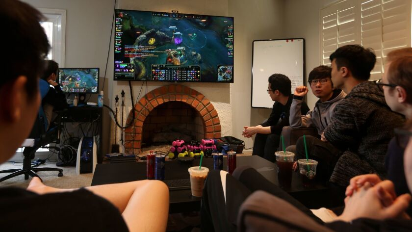 "Cloud9's ""League of Legends"" team goes over the replay of a recent online game at the house where they live and practice."