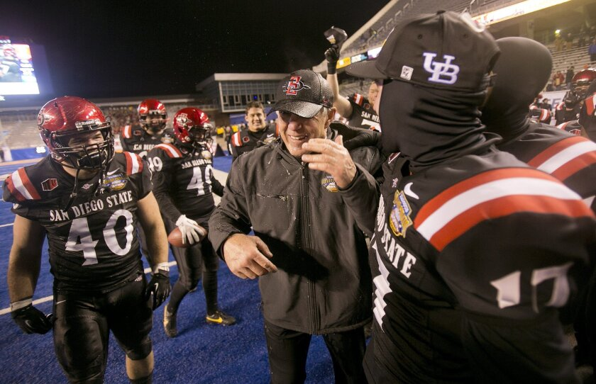 San Diego State head coach Rocky Long celebrates with his team after the teams win against Buffalo. San Diego State defeated Buffalo 49-24 in the Famous Idaho Potato Bowl at Bronco Stadium in Boise, Idaho. Saturday December 21, 2013