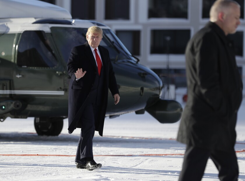 President Trump waves as he arrives in Davos on Marine One on Tuesday.