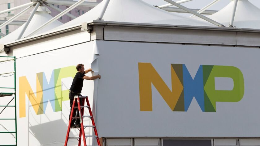 A man works on a tent for NXP Semiconductors in preparation for the 2015 International Consumer Electronics Show (CES) at Las Vegas Convention Center in Las Vegas.