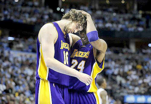 Kobe Bryant and Pau Gasol embrace as they put the finishing touches on the Denver Nuggets in Game 6 on Friday night.