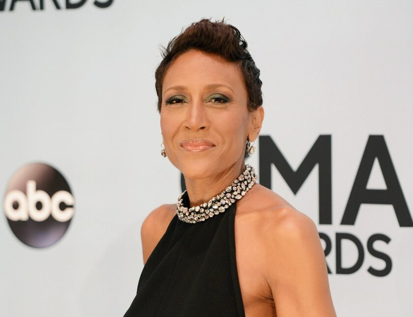 """FILE - This Nov. 6, 2013 file photo shows Robin Roberts at the 47th annual CMA Awards at Bridgestone Arena in Nashville, Tenn. The """"Good Morning America"""" co-host Roberts will receive the 2014 Walter Cronkite Award for Excellence in Journalism from Arizona State University's Cronkite School. The university announced that Roberts will receive the award during an Oct. 6, 2014, luncheon in Phoenix. (Photo by Evan Agostini/Invision/AP, File)"""