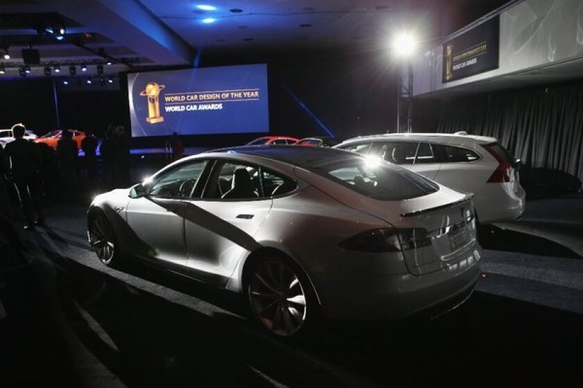 A Tesla Model S at the New York Auto Show. First-quarter sales of the car topped those of the Chevy Volt and Nissan Leaf.