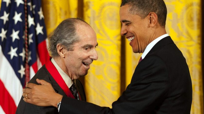 President Barack Obama presents the National Humanities Medal to Philip Roth in 2011.
