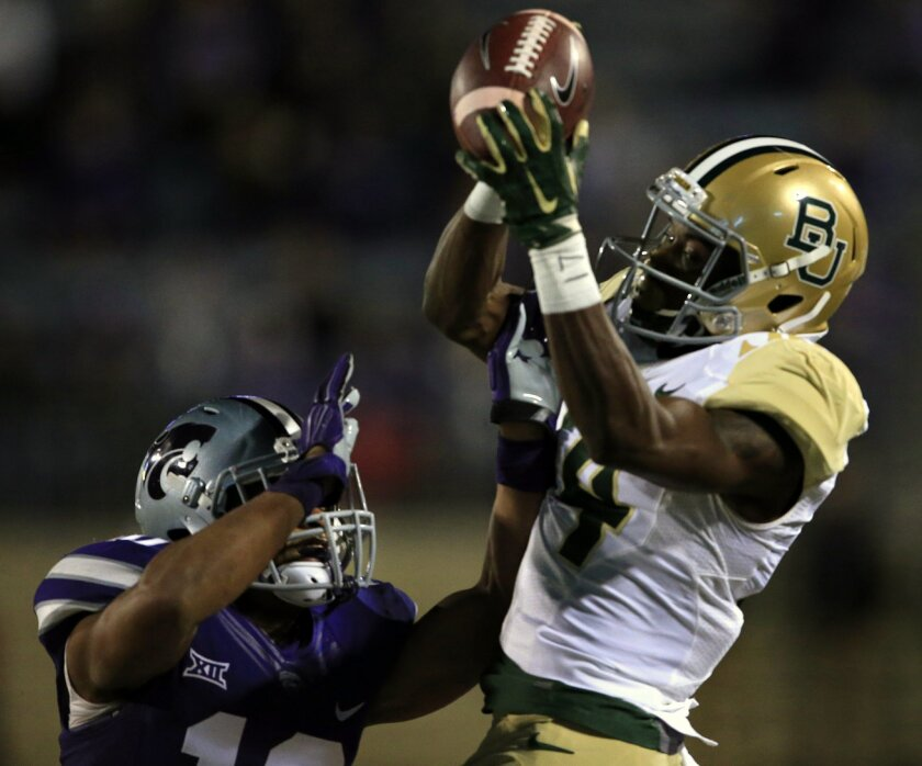 Kansas State defensive back Donnie Starks, left, breaks up a pass intended for Baylor wide receiver Chris Platt (14) during the first half of an NCAA college football game in Manhattan, Kan., Thursday, Nov. 5, 2015. (AP Photo/Orlin Wagner)
