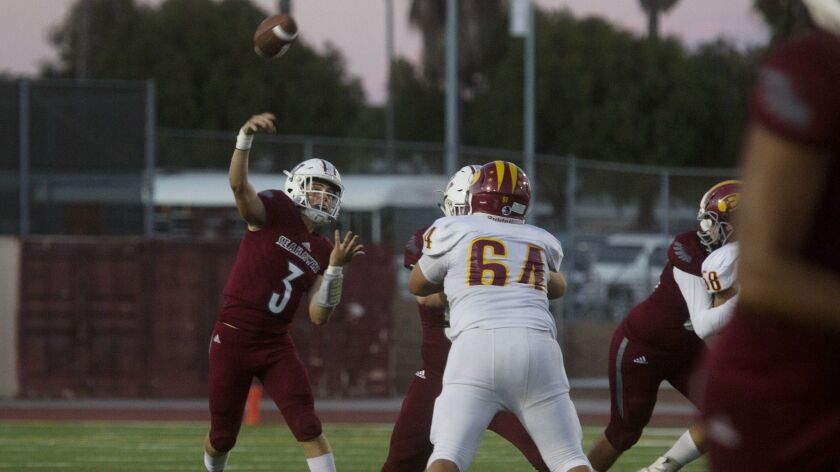 Noah Hickman throws a long pass during Ocean View High's game against Estancia on Friday. The quarterback passed for 126 yards and two touchdowns.