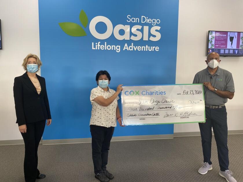 Cox Communications' Sam Attisha delivers $300,000 check to San Diego Oasis CEO and president Simona Valanciute