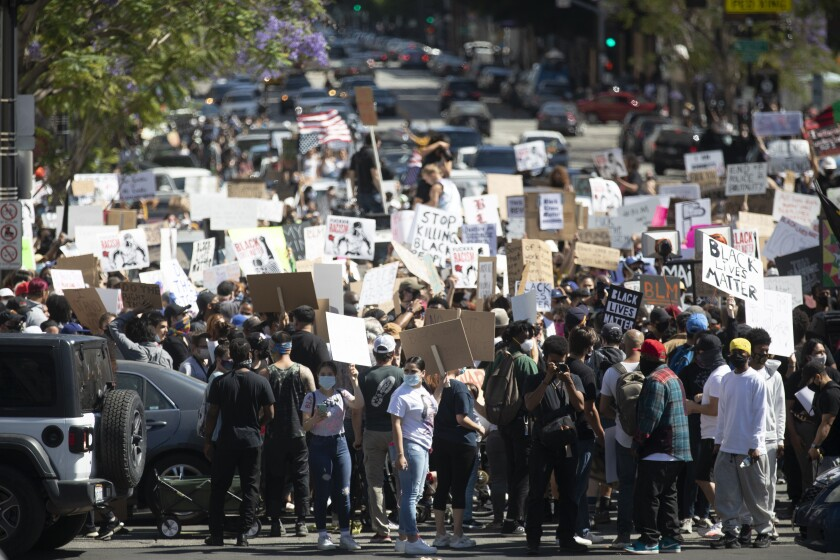 Thousands participate in a peaceful march through Hollywood on Sunday.