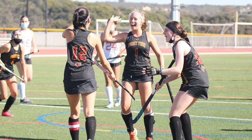 Faith Choe (#12), Jans Croon (#1) and Sophie Rosenblum celebrate a Choe goal (assisted by Croon) vs. Canyon Crest.
