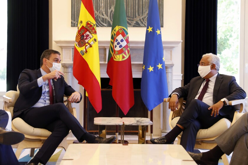 Spain's Prime Minister Pedro Sanchez, left, is received by Portugal's Prime Minister Antonio Costa at the Sao Bento palace in Lisbon, Monday, July 6, 2020. (AP Photo/Armando Franca)