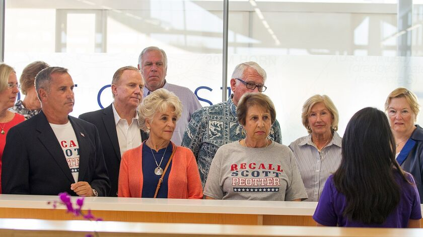 Members of the Committee to Recall Scott Peotter drop off their recall petitions in October at the Newport Beach city clerk's office. The group raised close to $100,000 and tallied more than $130,000 in bills in last year's effort.